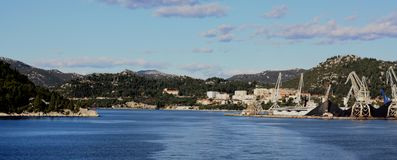City of Ploce with cargo harbour distance view. Ploce,  Ploče near Dubrovnik. panoramic view of city and cargo harbour with cranes and oar Stock Photo