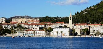 City of Ploce panoramic view. Ploce,  Ploče near Dubrovnik viewed from ferry dock. sea in foreground Royalty Free Stock Images