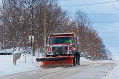 City plow cleaning a street Stock Photo