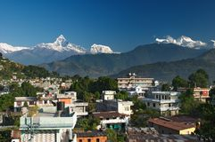 City of Pokhara. And Machhapuchhre mountain on background , Nepal Royalty Free Stock Photos