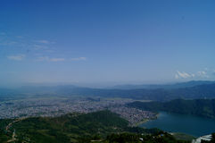 City of Pokhara and Fewa Lake. Wider view of City of Pokhara, one of the most visited tourists destinations in Nepal and  Fewa lake as seen from a viewpoint of Stock Photography