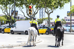 City police on horseback, Barcelona. Barcelona, Spain - April 21, 2015: City police on horseback in Ramblas. This police force is called Guardia Urbana de Royalty Free Stock Images