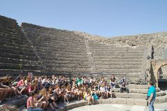 City of Pompeii. Amphitheater. Group of tourists stock photography
