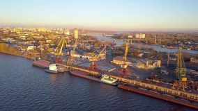 City River port. City port with crane loading cargo on barge in sunset light stock video