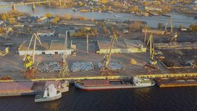 City River port. City port with crane loading cargo on barge in sunset light stock footage