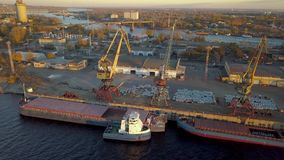 City River port. City port with crane loading cargo on barge in sunset light stock video footage