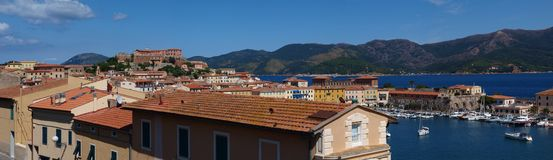 City of Portoferraio, Isle of Elba, Italy. The panorama of the city of Portoferraio on the Isle of Elba, Italy, with the dominating Fort Stella, seen from the Stock Images