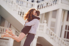 City Portrait of the young couple in love on a sunny day. Outdoor fashion portrait of happy smiling couple in love having fun together end enjoy their love and Stock Photos