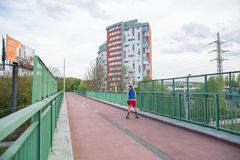 City Prague, Czech Republic. The man rolls on roller skates. City street with buildings from pedestrian bridge. Travel photo 2019 stock photo