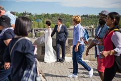 City Prague, Czech Republic. Man with woman stay pose for the photographer. Weddings models, photo session process on the charles stock image
