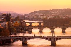 The city of Prague at sunset and bridges over the river. Views of the city and the bridges over the Vltava royalty free stock images
