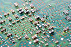 City on a printed circuit board. Stock Photos