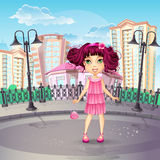 City promenade with a teen girl in a pink dress Royalty Free Stock Photo