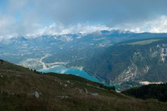 The lake of Santa Croce in Belluno, and in the background the Alpago mountains stock image