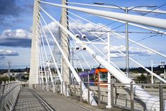 City public transport tram is moving along the cable Tilikum Crossing Bridge with concrete central columns across the Willamette royalty free stock images