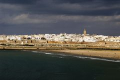 City of Rabat, Morocco. View of Moroccan city of Rabat with sea in the foreground and dark sky above Royalty Free Stock Photo