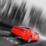 City Racing. Red sports car on a black/white background Stock Image