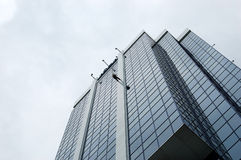 City Rappel. Women rappeling a downtown office building stock photo