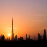 City in the rays of the setting sun Stock Photos