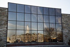 City Reflections. The City Hall of Schenectady, New York, is reflected in the windows of a nearby office building Stock Images