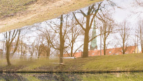 City reflections. Tree and city reflections in canal Stock Photography