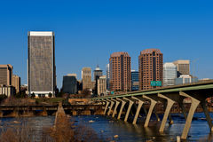City of Richmond Virginia. The city of Richmond, Virginia seen from the Flood wall surrounding the James River.  The Manchester Bridge into the city also Stock Image