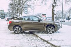 BMW X6 brown color, urban city street. Snow and cold weather. Travel photo 2019 royalty free stock photos