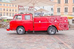 Old fire truck car at street. Urban city photo. City Riga, Latvia. Old fire truck car at street. Urban city photo. Street, way and buildings. 04.05.2018 Stock Photos