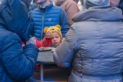 City Riga, Latvia. Street Restaurant food festival. The child tastes the food