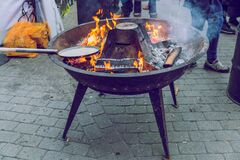 City Riga, Latvia. Street Restaurant food festival. On the fire is being prepared to eat