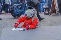 City Riga, Latvia. Street Restaurant food festival. Girl drawing