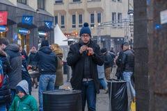 City Riga, Latvia. Street Restaurant food festival. Man tastes the food
