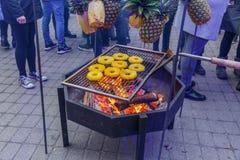 City Riga, Latvia. Street Restaurant food festival. Pineapples are fried on the street