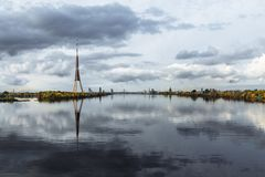 City Riga, Latvia. TV tower at Capital. Big building at city center. Travel photo - Beautiful blue river Daugava with royalty free stock images