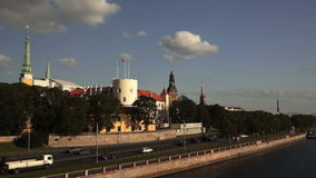City trafic at Riga castle. Riga city panorama behind the clouds stock video footage