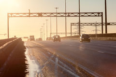 City ring road at sunset with silhouettes of driving cars stock photos