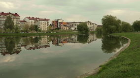 City on the river. Autumn evening. Smooth dolly shot stock footage