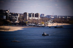 City on river, beach and pier landscape Royalty Free Stock Images