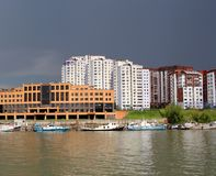City on the river boats of a multistory building modern city river navigation of river ships, the shipyard Marina pier waterfront royalty free stock image