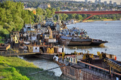 City river with old cargo ships Stock Photography