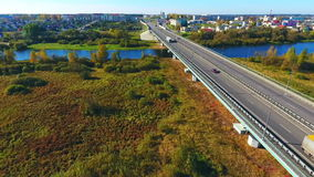 Highway road in city landscape. Urban road landscape view. City road aerial view. Sky view cars moving on highway road in city. Cars driving on highway city stock footage