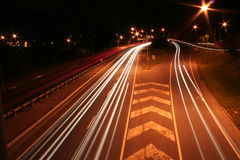 City road with car light streaks Stock Photo