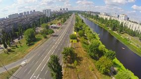 City road with cars, beautiful river, aerial view from drone. Stock footage stock footage