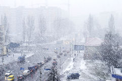 City Road with cars in time of heavy snow in the winter Royalty Free Stock Images