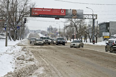 City road cleared from snow Stock Photos