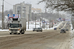 City road cleared from snow Stock Image