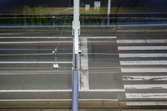 city road with crosswalk and tram lines Royalty Free Stock Image
