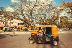 City road with driving indian taxi autorickshaw Royalty Free Stock Images