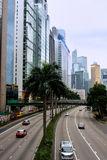 City road of Hongkong. View of street in Hongkong center area, as buildings, traffic and vehicle, shown as city view and transportation, and people living Stock Photography