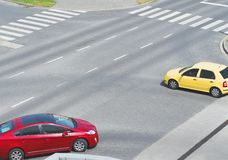 Intersection with Yellow and Red Car Stock Photos